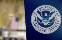 A U.S. Department of Homeland Security (DHS) sign stands at Ronald Reagan National Airport (DCA) in Washington, D.C., U.S., on Wednesday, Feb. 25, 2015. Financing for the DHS is set to lapse after Friday and the agency would face a partial shutdown unless Congress provides new money. More than 200,000 government employees deemed essential at DHS, including Transportation Security Administration (TSA) officers, would still have to report to their posts, even though their pay would stop unless Congress finds a solution. Photographer: Andrew Harrer/Bloomberg via Getty Images