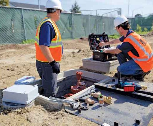 Echologics field engineers install a permanent leak detection node to monitor a critical water transmission main for the development of leaks during construction pile driving activity near the main.
