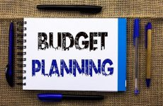 Conceptual hand writing showing Budget Planning. Business photo text Financial Plannification Evaluation of earnings and expenses written Notebook Book the jute background Pens next to it.