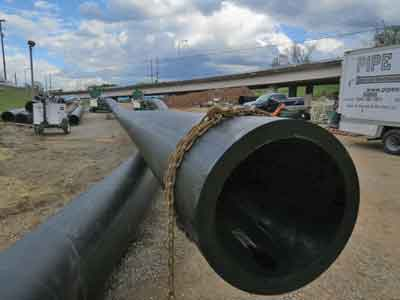 Several sections of the nearly 1,600 ft of the new 24-in. pipe installed under the river.
