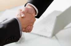 Businessmen coming to an agreement by shaking hands