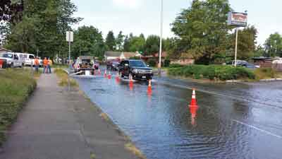 Limited stormwater conveyance and subsequent ponding may require traffic control beyond that required for operator safety. Courtesy of Susan Fenhaus